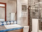 Great design on this en-suite bathroom. The shower/tub combo provides some nice options.