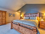 Enjoy a comfortable night's rest in Master Bedroom 1, located up a flight of stairs from the main level.