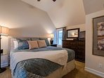 Just upstairs, Master Bedroom 1 is comfortable and spacious with a king bed...