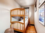 Adjacent to the master on the first floor is a small guestroom, complete with bunk bed.