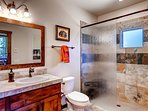 The private bathroom to Master Bedroom #1 has a walk-in shower with a shelve seat.