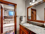 This shared bathroom between Guest Bedroom #2 and #3 has a vanity and a tub/shower combo.