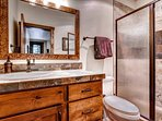 Guest Bedroom #4 has its own bathroom, shown here, with its vanity and walk-in shower.