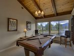 The pool table is a great way to relax with friends after a long day outdoors.