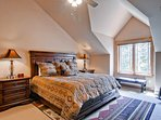 On the top level, the master bedroom #2 has a king bed, TV, private bath, and cathedral ceilings.