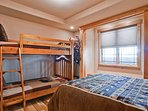 The main level bedroom #3 includes a queen bed and twin bunks, but only has access to a 1/2 bath on this level.