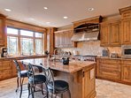 With two undermount sinks, high end Wolf appliances, and a Sub-zero fridge, this kitchen would please even Julia Child...