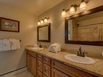 This shared Guest bathroom #2 on the second floor contains double sinks and a shower/tub combination