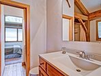 The shared Jack-n-Jill bathroom between the upstairs bedrooms #3 and #4 has a tub/shower combo.