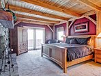 The Moose King master bedroom (#1) has a king bed, fireplace, TV, and private bath. There are glass doors, but the...