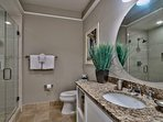 This bathroom, featuring a shower and single sink vanity, is en-suite to Guest Bedroom 2 for maximum convenience.