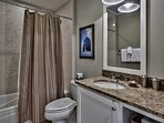 The hallway bathroom features a shower/tub combo.