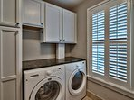 Even the laundry room has plenty of counter and storage space.