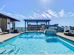 Make a splash under the fountain or lounge on one of the comfy chairs at the rooftop community pool.
