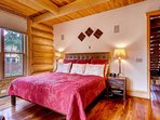 The master bedroom is a great place to relax after a long day on the slopes.