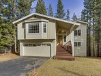 Nestled Pines Retreat is surrounded by pine trees in a quiet neighborhood adjacent to a national forest.