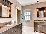 The private bath for master bedroom #2 has a walk-in shower and his and hers vanities