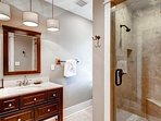 The carriage house master bedroom's private bath has a walk-in shower