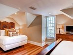 There are two queen beds in the carriage house loft, along with a small flatscreen TV