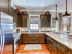 The kitchen features stainless appliances, granite counters, and nice wood cabinetry