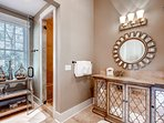 The master bath for bedroom #1 has a walk-in shower and elegant vanity