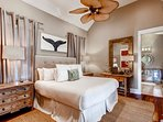 The 2nd floor master bedroom (#1) has a king bed, flatscreen TV, and private bath