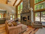 Snuggle up by the huge stone fireplace in the living room that also opens up to the patio.