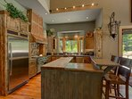 The open-concept kitchen with high-end appliances and plenty of counter space is rather welcoming to any chef.