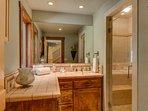 It too has an en-suite bathroom with single-sink vanity.