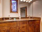 The private bathroom to Master Bedroom #1 features a double vanity.