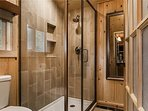 The bathroom has that modern feel, but a quick peek out the window will remind you just where you are. The heated...