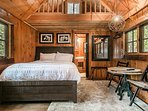 The queen bed in your final cabin, Upper Daves, has a studio-like feel.
