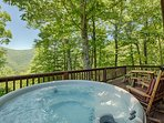 Private hot tub on the back deck has stunning views of the mountain, sunrise and stars. Relax, enjoy
