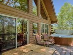 Back deck has a private hot tub, rocking chairs, dining table and new, 5-burner gas grill. Perfect!