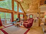 Large windows, Mountain Views. Private hot tub on the deck right outside the living room.
