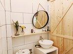 Bathroom with wooden barn door :)