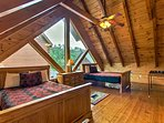 Two rooms upstairs enjoy A-frame ceilings and amazing views.