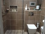 Shower Wet Room, Toilet & Vanity, fully tiled with large towel radiator & electric skylight