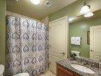 guest bath has a shower/tub combo