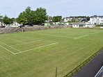 Ballycastle tennis club grass courts being prepared for summer season.