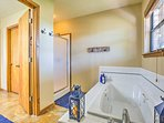 Rinse off in the walk-in shower, or soak in the large tub.