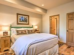 The second bedroom features a plush queen bed.