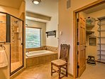 The bathroom includes a soaking tub and walk-in shower.