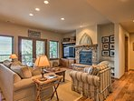The lower level hosts a gas log fireplace and flat-screen Smart TV.