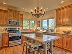 Cook with ease using the fully equipped kitchen's stainless steel appliances.