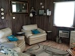 Living area with books and games. 32' t.v. with DVD/VCR, radio, and weather band radio.