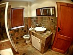 Single room ensuite bathroom with a shower.