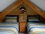 Mezzanine gallery loft bedroom with 2 single beds