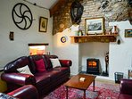 Open plan lounge with original old farm implements  keeping the character of the cottage alive