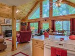 Even the chef has a view in this beautiful cabin.Open floor plan w huge windows for mountain views